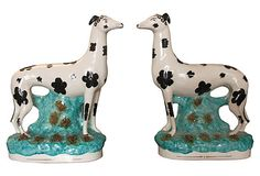 Wonderful pair of mid-19th century Staffordshire spotted dogs standing on a grassy knoll surrounded by flowers.