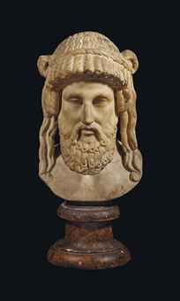 A ROMAN MARBLE HEAD OF DIONYSOS CIRCA 2ND CENTURY A.D.