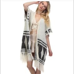 Aztec Fringe Cardigan Trendy cardigan that's super soft and cozy. Ivory fringe cardigan with tribal prints. Very versatile great with leggings, jeans or dress.                                                             One size. Stretchy fabric made of cotton and acrylic.                                                                        Please do not purchase this listing. Comment below for your bundle listing. Gin Sweaters Cardigans