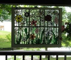 Repurposed old windows, mosaics