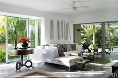 The Florida living room of writer Judy Blume and her husband, George Cooper. Kuba-cloth pillows ornament the B Italia sectional sofa; the wall sculpture is by Susan Rodgers, and the circular table is by artist Cindy Wynn.