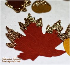 die cut leaves dipped in glitter for fall table scatter or glam tags!