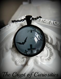 Gothic black and grey graveyard and bat cameo necklace by TheCryptOfCuriosities