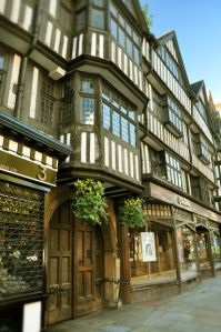 The most intact example of Elizabethan half-timbering left in central London is the façade of the Staple Inn, it dates from 1545. The building barely escaped the Great Fire of London of 1666 due to a contemporary form of fire-protective plastering which was applied to its front façade at the time. The site was originally a wool market during the 13th century and its name derives from the term Staple a duty on wool introduced in 1275 B. Lowe