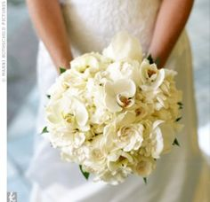 Her unique, all-white bouquet featured mini calla lilies, peonies, dendrobium orchids, nerine lilies, and garden roses