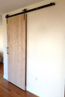 We eliminated the old double doors at the pantry and replaced them with a single sliding barn door. The barn door allows for larger access to the pantry and also creates a stunning visual element to the new kitchen!