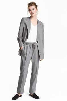 Trousers in lightly brushed twill with an elasticated drawstring waist, side pockets and tapered legs with creases.