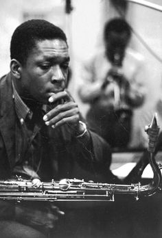 "John Coltrane at a recording session of Miles Davis' Album, ""Kind Of Blue"". S)"