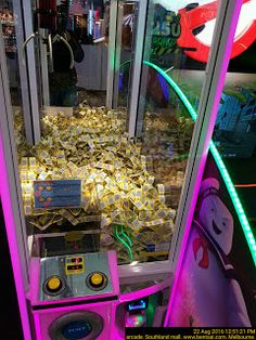 Arcade claw machine with game tickets as trophy   Claw Entertainment Melbourne Ticket Trophy
