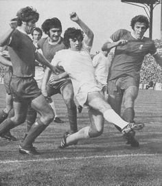 18th September 1971. Peter Lorimer causing mayhem in the Liverpool defence as Emlyn Hughes, Larry Lloyd and John Toshack desperately try and stop 'Hot Shot'.
