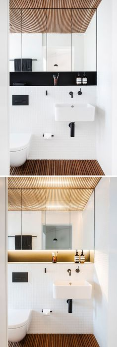 This Modern Bathroom Features A Timber Slat Floor And Ceiling To Introduces  Texture And Tactility, While The White Tiles And Large Mirror Help To  Brighten ...