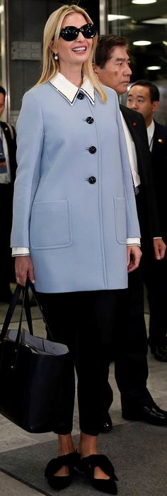 Details: Ivanka paired the statement jacket with black tailored pants and black  flats with a