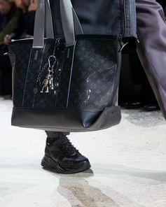 A Monogram Eclipse Glaze bag from the Louis Vuitton Fall-Winter 2018 Fashion Show by Kim Jones. See all the looks now at louisvuitton.com.