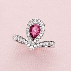 Joséphine Aigrette stackable ring in white gold set with brilliant-cut diamonds and a pear-shaped rhodolite garnet.