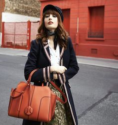 """Orange mood "": Louise Ebel wearing her Tod's Sella Bag. #Tods #TodsSellaBag"