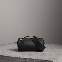 A cylindrical micro bag by #Burberry in block-colour leather. Use the military-inspired belt strap to carry it crossbody or on the shoulder