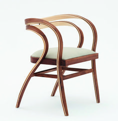 The design of this chair was inspired by the efficient yet beautiful forms of wooden naval structures. #ModernChair #ChairDesign #FurnitureDesign #Seating #Woodworking