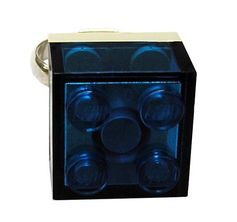 Transparent Blue LEGO® brick 2x2 on a Silver/Gold plated adjustable ring finding* Selected and rare color of the LEGO® brick * If you have a preference for the metal of the ring finding, dont forget to clarify it. REMINDER LEGO® is a trademark of the LEGO Group which does not sponsor, authorize