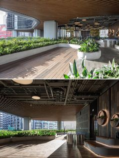 Low curved borders define the planted areas of this building's outdoor space.