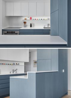 Aiming to keep the countertops clutter free, this appliance garage blends into the surrounding matte blue cabinets of this modern kitchen. #ApplianceGarage #CoffeeStation #KitchenDesign #MatteBlueKitchen #WhiteCountertops