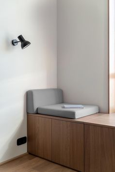 A modern window seat with a wood bench.