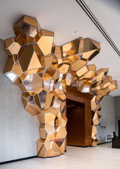 The form of  'Grotta Aeris' was inspired by the crystalline growth of natural elements, and to achieve that look, SOFTlab created the structure in copper-finished composite panels. #Sculpture #Art #Design