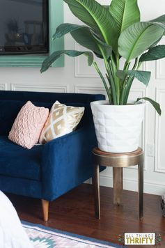 Blush, Navy, Yellow Master Bedroom refresh by adding plants, new throw pillows, rug and window treatments.