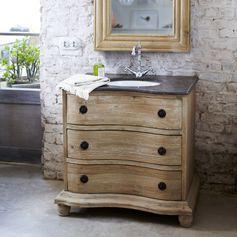 Ce meuble en pin brut recyclé est surmonté d'un superbe plateau en pierre bleue accompagné d'un lavabo en céramique blanc. #tikamoon