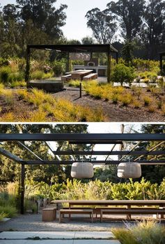 An outdoor dining area underneath a pergola with hanging lights and a wood fire pizza oven.