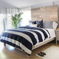 Dramatic before and after of a rustic nautical master bedroom makeover... and the story of how Lauren & Mark found their shared style.