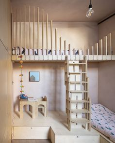 In order to allow two children to sleep in this bedroom, a bunk bed has been designed with wood fins as a safety feature. A play area has also been included and is raised to accommodate additional storage underneath. #KidsBedroom #BunkBeds #InteriorDesign #BedroomDesign