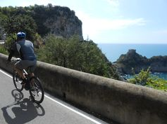 Cycling by the Conca Cape.