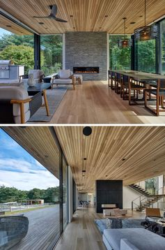Living Room Ideas - Inside this modern house, the main social areas, like the living room and dining room all share the same open room. Two fireplaces, one at each end of the room, and wood ceiling and flooring, add warmth to the space. #LivingRoom #DiningRoom #LivingRoomIdeas #InteriorDesign #WoodCeiling