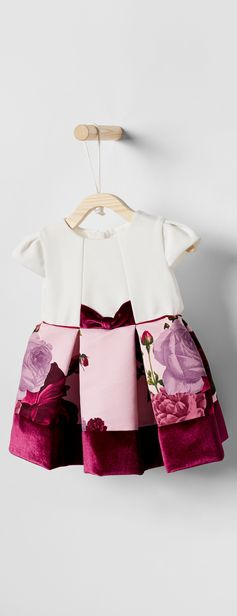 Get your little one set for special occasions in Ted's oh-so pretty ELVIRRA dress. Featuring a plain bodice and rose print skirt, it's trimmed with velvet details for a party-perfect finish.