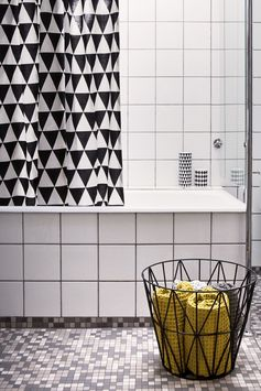 "black and white geometrical shower curtain. To see more of the geometric design trend, follow Jill Jordan's board ""Trending Triangle: Geometric Pattern Deigns"""