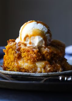 Pumpkin Earthquake Cake is hands down one of the best pumpkin cake recipes ever! It's soft, and has that signature crackly top, swirled with buttery, cream cheese and coconut! #cookiesandcups #earthquakecake #cake #recipe #baking #fallbaking #pumpkinrecipe