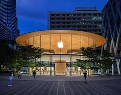 Apple Central World features a eye-catching cylindrical glass facade with views of a large sculptural wood core.