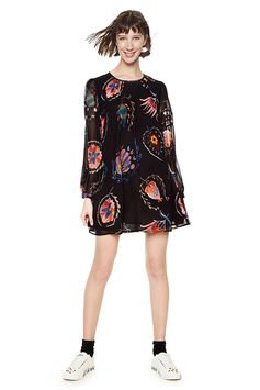 Women's black long-sleeved straight cut dress with inner lining and printed sheer fabric.You can´t go wrong with a dress! Discover Desigual dresses selection on our website.