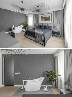 In this modern bedroom, sculptural lighting fixtures add an artistic flair, while a grey-tiled section of the floor is home to a freestanding bathtub. #ModernBedroom #BedroomWithBathtub #GreyBedroom