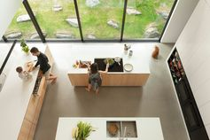 A modern kitchen with three kitchen islands that each have different functions.