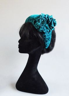 Made with passion this velvet halo hat of two colours sea blue / green with handmade flowers