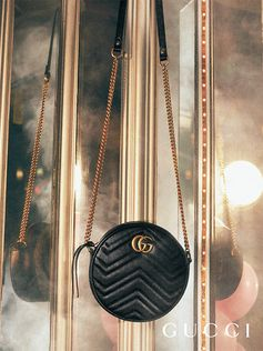 A new shape from Gucci Cruise 2019 by Alessandro Michele, the rounded GG Marmont bag features the Double G hardware and a chain shoulder strap.
