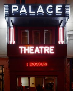 A neon sign on the façade of Théâtre Le Palace reads 'I Dioscuri', a reference to Leo de Berardinis and Perla Peragallo—the duo is regarded as the I Dioscuri of avant-garde theatre. A part of their film 'Charlie Parker' screened before the Gucci Spring Summer 2019 fashion show. 'Dioscuri' were half-twin brothers in Greek and Roman mythology with different fathers.