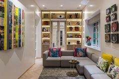 Shelving Idea - Add custom shelving that wraps around the doorway, increasing storage space and adding ambient light with hidden lighting. #ShelvingIdea #WrapAroundShelving #InteriorDesign