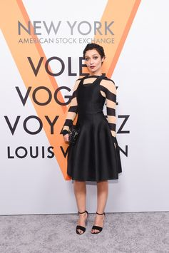 Ruth Negga wearing a look from the Spring-Summer 2018 Collection by Nicolas Ghesquiere at the opening of the Louis Vuitton Volez, Voguez, Voyagez Exhibition at the historic American Stock Exchange in New York City.