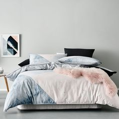 Featuring a simple, geometric splice design in a beautifully soft, pastel colour palette, the Ion quilt cover set from Home Republic offers an elegant, understated look with subtle paint splatter detailing. The coordinating European pillowcases are a quilted charcoal and offer a sophisticated touch.