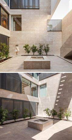 This internal courtyard has lines of plants, a water fountain, and hidden lighting that creates a soft glow at night. #InternalCourtyard #CourtyardLighting #OutdoorSpace