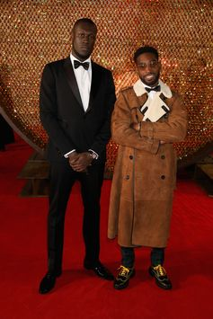In Burberry tailoring and outerwear, Stormzy and Tinie Tempah at the 2017 Fashion Awards in London