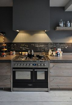 I normally don't love dark kitchens but am loving this.  It's warm and i love the thick countertop, plank cabinets and the chic exhaust.
