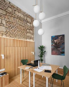 This modern apartment has a room dedicated to a home office, that has high ceilings and original brick details. #HomeOffice #InteriorDesign